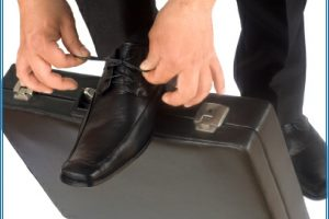 Lacing up shoes on a briefcase